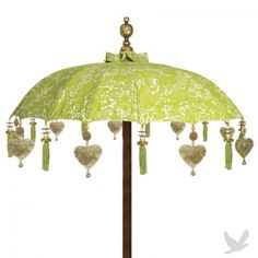 "34"" Celestial Green Tabletop Bali Umbrella - Decorate your wedding event with this unique printed ""Celestial Green"" canvas Balinese umbrella with tassels, gold tin hearts & brass bell dangles. This umbrella is made with Ikat fabric, and sustainably grown wood. A ''carved wooden base for table-top use'' -  http://www.koyalwholesale.com/pages-productinfo-category-1476-product-21848/tabletop_bali_umbrellas_-_new34_celestial_green_parasol_umbrella.html"