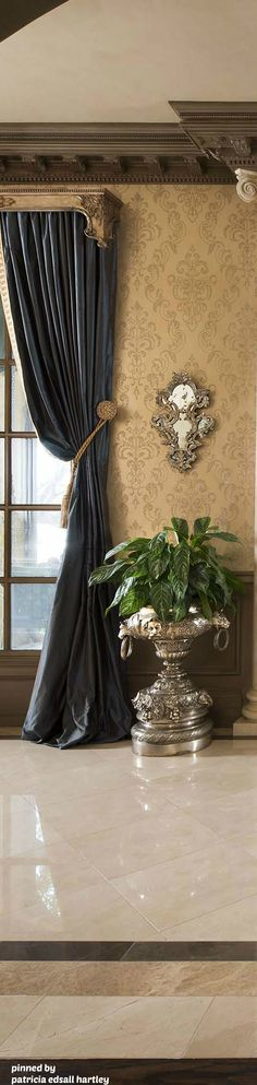 ornate classical crown moulding, simple draperies with wood cornice, holdback, and tassel tieback.  Custom Old World Draperies DesignNashville.com
