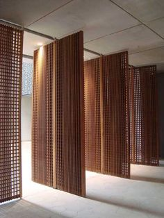 Decorative timber architectural Screens. Functional yet aesthetically pleasing. Would work well as a divider of the indoors from the outdoors, or a decorative feature wall on the inside. the small holes in the screens make for wonderful warm lighting.