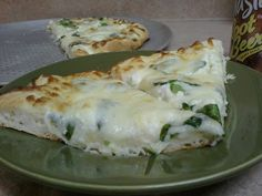 White (no tomato sauce) pizza recipe with spinach, artichoke hearts and lots of garlic