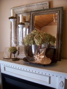Layering the mantle decor. I like the double mirror idea