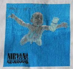 """Nirvana's """"Nevermind"""" cover in cross-stitch"""