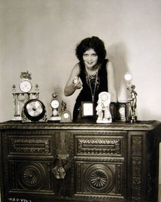 Clara Bow in a horologists dream, bedecked with pearls.  Eternal Tools like this picture on so many levels!