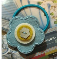 Love the simple flower - would be cute on headband too!