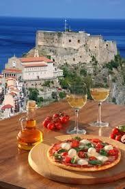 Pizza in Calabria with Scilla Castle in the backround.
