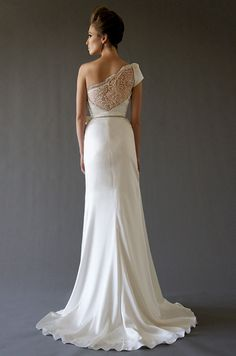 An asymmetric lacy back on this #wedding dress from Cocoe Voci, Fall 2012