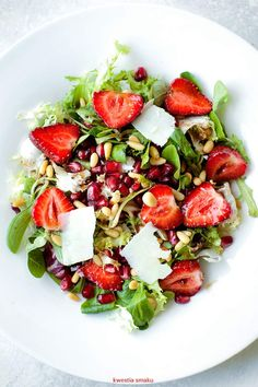 Strawberry and pommegranate salad with pecorino cheese and balsamic glaze.