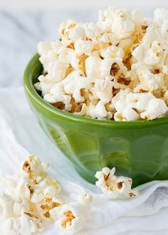 I was watching Southern at Heart on the Food Network and Damaris made popcorn using a method that I have never seen before. She swore by it, and now so do I. Not only did I not burn the popcorn, all of kernels popped, and I finally got a bowl of warm buttery perfect stovetop popcorn.