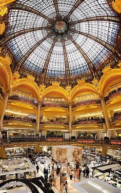 Galeries Lafayette. In 1895, Théophile Bader and his cousin Alphonse Kahn opened a fashion store in a small haberdasher's shop at the corner of rue La Fayette and the Chaussée d'Antin, Paris. Bader commissioned Georges Chedanne and then his pupil Ferdinand Chanut to design the layout of the Haussmann location. A glass and steel dome, and Art Nouveau staircases were built in 1912.