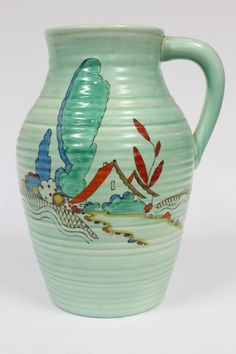 Clarice Cliff Single Handled Vase, green glazed with hand painted house design, factory mark t base, h 29.5cm
