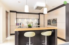 We recommend that you have your extractor fan over your kitchen island. They don't have to be bulky and can be hidden away cleverly.