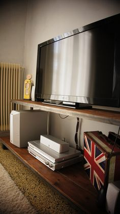 Handmade TV stand with soaked wood and aged iron.