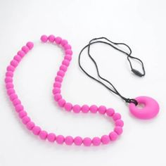 Sassy Baby Beads Silicone Teething Chew Beads Necklace Sensory Tool 2 Piece Set (Fuchsia Pink) by Sassy Baby Beads, http://www.amazon.com/dp/B00FBDH53G/ref=cm_sw_r_pi_dp_4rZssb160YQCH