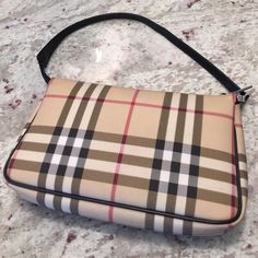 ✨Burberry Classic Nova Check Pouchette✨ A classic Burberry mini bag perfect for date night. In great condition. No rips or tears. Slight wear on under side of zipper. See pic. Sorry, no dust bag. Burberry Bags Mini Bags