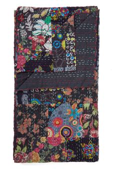With Flying Colorful Blanket. This black quilt by Karma Living quickly stole your heart with its vibrant floral patches and pink and white stitching! #multi #modcloth