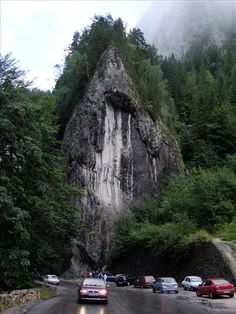 The road that cuts in two the Bicaz Gorges is among Romania's most spectacular. The gorge twists and turns uphill for cutting through limestone rocks. Visit Romania, Russia Ukraine, Tourist Places, Medieval Castle, Homeland, Just Go, Cool Pictures, Waterfall, Beautiful Places