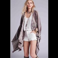 Free People poncho kimono With its tonal palette and relaxed silhouette, Free People's cotton and linen-blend poncho embraces the brand's chic bohemian edge. Complete with cut-out sleeves, slip pockets and a dipped side hem, this knitted design is an obvious choice for festival styling. Color is depicted in photos 2,3 and 4   Retail: $168 Sizes: Small and large  ❤I have over 300 new with tag Free People items for sale! I love to offer bundle discounts!  ❤No trades. Please use the offer…