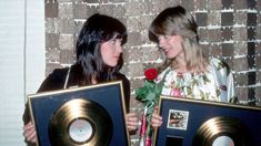 Ann Wilson and Nancy Wilson of the rock and roll band 'Heart' holding gold records in May of 1977. Michael Ochs Archives/Getty