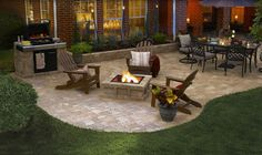 A Pavestone Rumblestone™ patio with all of the best party features- fire pit, grill, and dining table