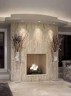Fireplace wrapped in vertical stone - it's nearly like what I want to do...... imagine dark-gray ledger stone..... with lights like this on a trac More