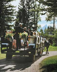 A wagon chariot is the perfect transportation for a summer wedding party