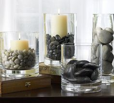 Use river rocks to anchor pillar candles, or set them in the bottom of clear vases for a more dramatic flower display. Support Bougie, Zen Bathroom Decor, Zen Space, Zen Room, Clear Vases, Vase Arrangements, Rock Decor, Crystal Vase, Clear Crystal