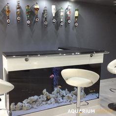 L-Shaped Bar Aquarium - A modern hi-gloss L-shaped aquarium, the perfect accompaniment to a cool, modern grey colourscheme.