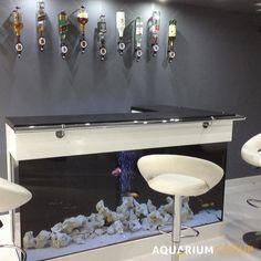 L-Shaped Bar Aquarium - A modern hi-gloss L-shaped aquarium, the perfect accompaniment to a cool, modern grey colourscheme.
