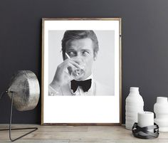 Shaken Not Stirred Roger Moore Poster - PRINTABLE FILE. James Bond 007 and The Saint Roger Moore - Martini 1968. British actor Roger Moore is drinking a martini and holding a cigarette.Shaken Not Stirred Roger Moore was shot in 1968 by William Lovelace. This is INSTANT DOWNLOAD - a printable file. Please note that NO physical items will be sent. The colour quality will vary depending on the type of printer and the paper you will use. ILKADesign is not responsible of the colour printed on t... Shaken Not Stirred, Roger Moore, Types Of Printer, James Bond, Martini, Opera, Gallery Wall, Printables, Interior Design