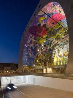 The Markthal Rotterdam by MVRDV opens in the Netherlands:  Inside the archway is the artwork, The Horn of Plenty, as well as a food market and retail shops.  The roof and sides of the arch are apartments.  Also, there's a 4-story underground car park.  2014