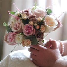 A selection of roses, eucalyptus, berries and a variety of other flowers