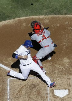 Yadier Molina looking for 4th trip to World Series | Los Angeles Dodgers' Adrian Gonzalez scores from second past St. Louis Cardinals catcher Yadier Molina on a hit by Juan Uribe during the second inning of Game 5 of the National League baseball championship series Wednesday, Oct. 16, 2013, in Los Angeles. (AP Photo/Morry Gash)