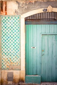 Tiffany blue door of the Azulejo house in Lisboa, Portugal. Discover restaurants, bars, shops, clubs & cultural hotspots that locals love in Lisbon: Mint Door, Aqua Door, Turquoise Door, When One Door Closes, Dream Art, Windows And Doors, Arches, Decoration, Beautiful Places