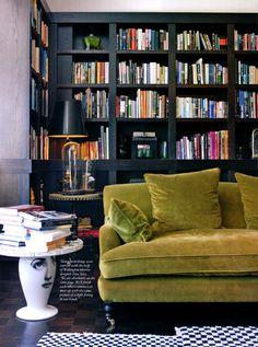 Mossy velvet + that side table + dark book case + geometric rug