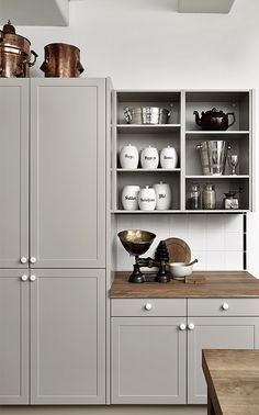 grey kitchen with tall cupboard