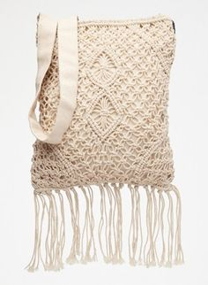 Over-the-shoulder bags go everywhere in the summer. We love this fringed bag by Roxy!