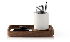 Modernize your desktop with desk accessories like the Pfeiffer Catch-All Tray crafted from solid wood. This desk organizer includes a removable cup.
