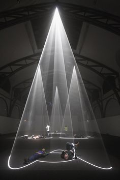 "Visitors experience the light and sound installation ""Five Minutes Of Pure Sculpture"" by British artist Anthony McCall on the first day the ..."