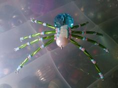 Green, pink and blue spider