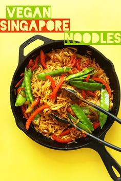 Vegan Singapore Noodles: garlic, soy sauce, sugar, lime, rice noodles, sesame oil, onion, bell pepper, snow peas, curry powder, tofu, Sriracha, green onions
