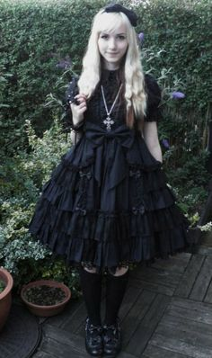 "Kuro Lolita. Kuro literally means ""black"". Kuro Lolita is the polar opposite of Shiro Lolita, and a typical Kuro co-ord includes all black pieces. Not to be confused with Gothic Lolita."