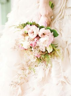 Soft pink Roses, Peonies, and Ranunculus.