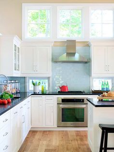 Midwest Living Lake Michigan Beach Home - Kitchen - Cottage Casual Style, love the colors and simple fresh look.  Love the blue subway tile, white cabinetry, dark countertops and the high windows.