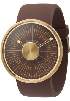 ODM Brown & Gold Hacker  Not to be confused with new radiotelescope dishes for SETI, these cool new ODM Hacker watches were released this week at Watchismo. The Hacker's deep, concave dial rises up from the sunken center, where form-fitting graphics lead your eye inwards. Behind the capped steel disc on top of the crystal, the hands indicate the time as negative space. Just imagine Marc Newson's iconic Ikepod, cut in half, then drugged with some very strong painkillers. Then you get the…