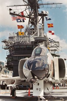Restored aircraft on the outdoor flight deck at the USS Midway Museum in San Diego.