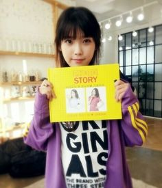 IU poses with photo book from fans