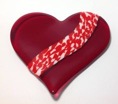 This unique, one of a kind heart plate is sure to make any heart skip a beat. It was designed and created in our studio with cherry red Transparent glass and custom red and white cane pulled in our studio using a special vitrigraph kiln. The cane was then cut in small pieces and
