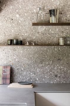 Terrazzo is back and better than ever before. From a chic statement bathroom to a boho eclectic office, here are five terrazzo-filled rooms we love. Kitchen Wall Shelves, Kitchen Tiles, Kitchen And Bath, New Kitchen, Kitchen Decor, Kitchen Cabinets, Kitchen Stone Wall, Order Kitchen, Gray Cabinets