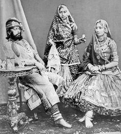 Maharaja Jaswant Singh II of Jodhpur with his Paswan Naini Jaan and a female attendant, late century photograph, Jodhpur. By Rohit Sonkiya Indian Attire, Indian Outfits, Monsoon Wedding, Royal Indian, Vintage India, Old Photography, Indian Textiles, Indian Heritage, Jodhpur