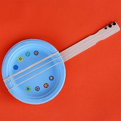 "Kids singing the ""I'm Bored Blues?"" Cheer up their tune with this fun DIY banjo craft made from paper plates and rubber bands. How-to by Parents Magazine. Paper Plate Crafts, Paper Plates, Paper Cups, Instrument Craft, Mandoline, Preschool Crafts, Kids Crafts, Kids Diy, Crafts For Preschoolers"